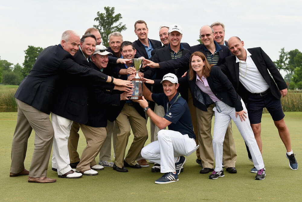 Justin Rose poses with the trophy and Zurich executives after winning the Zurich Classic of New Orleans at TPC Louisiana
